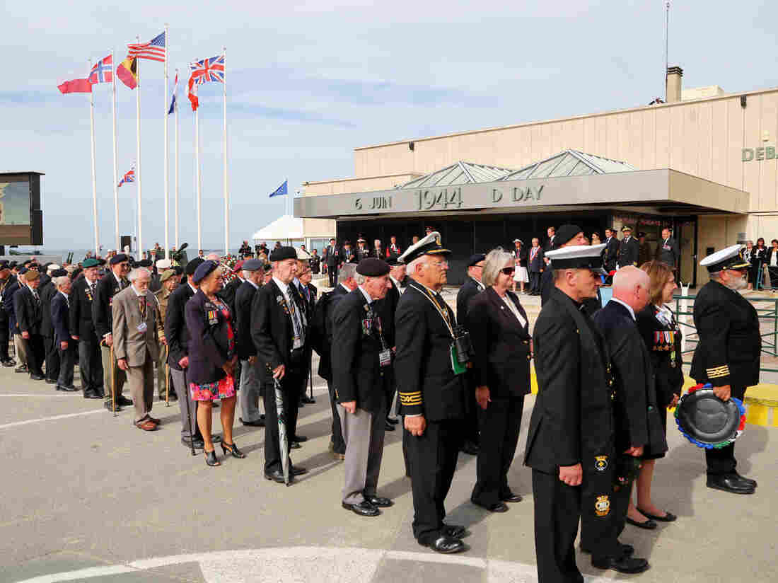 Normandy veterans parade in Arromanches, France, during events to mark the 70th anniversary of the D-Day landings.