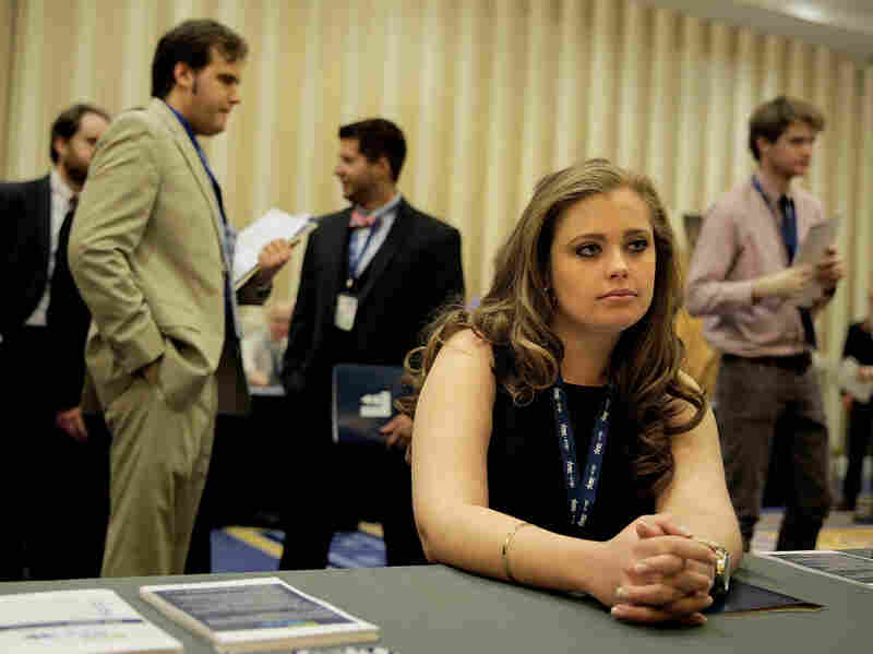 Kaitlin Foran, a senior at the College of Charleston in South Carolina, meets with a prospective employer at a job fai