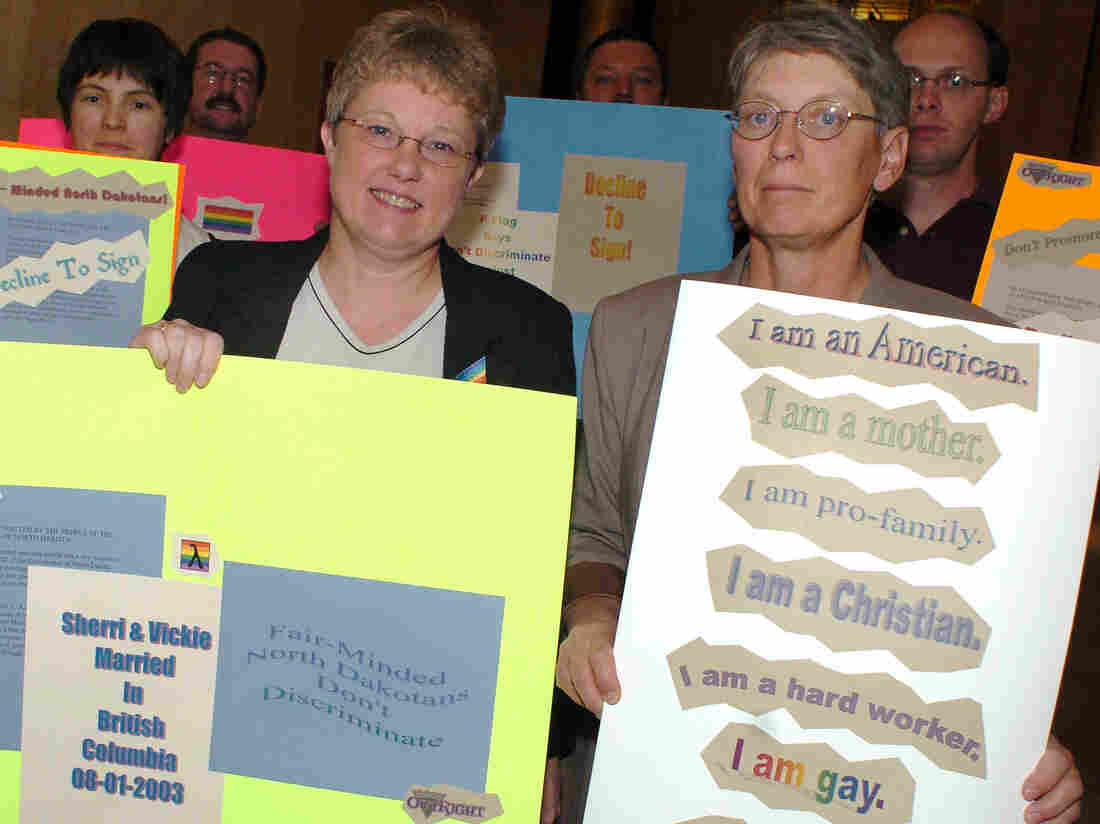 Sherri (front left) and Vickie (right) Paxon hold signs at the Capitol in Bismarck, N.D., in 2004, opposing the state's then-newly approved ban on same-sex marriage.