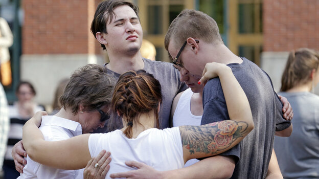 Students and faculty pray together following a shooting on the campus of Seattle Pacific University on Thursday.