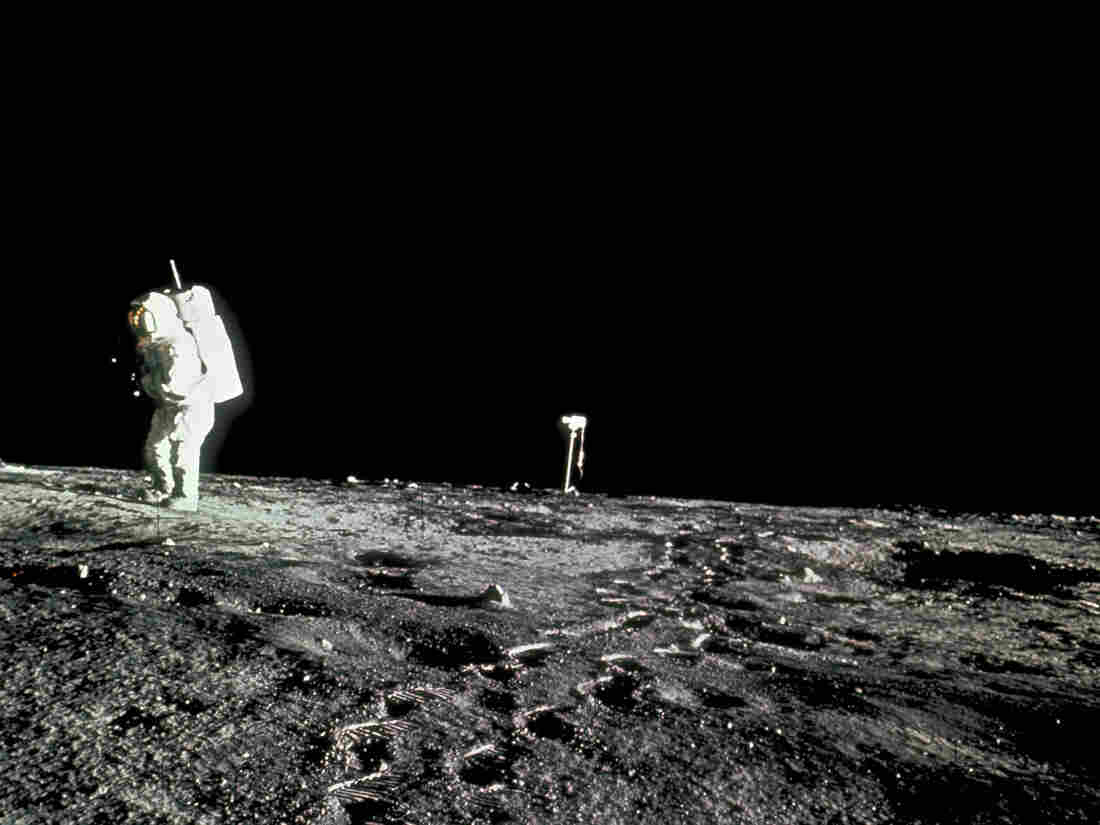 An Apollo 12 astronaut makes footprints on the surface of the moon, Nov. 19, 1969. Rocks collected on the mission were among those recently re-examined by a team of German astronauts.