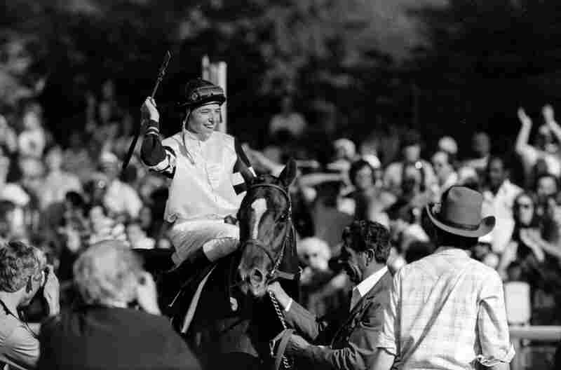 Jockey Steve Cauthen raises his arm in a victory salute after riding thoroughbred Affirmed to win the Belmont Stakes and the Triple Crown in 1978. Affirmed was the last horse to win the Triple Crown.