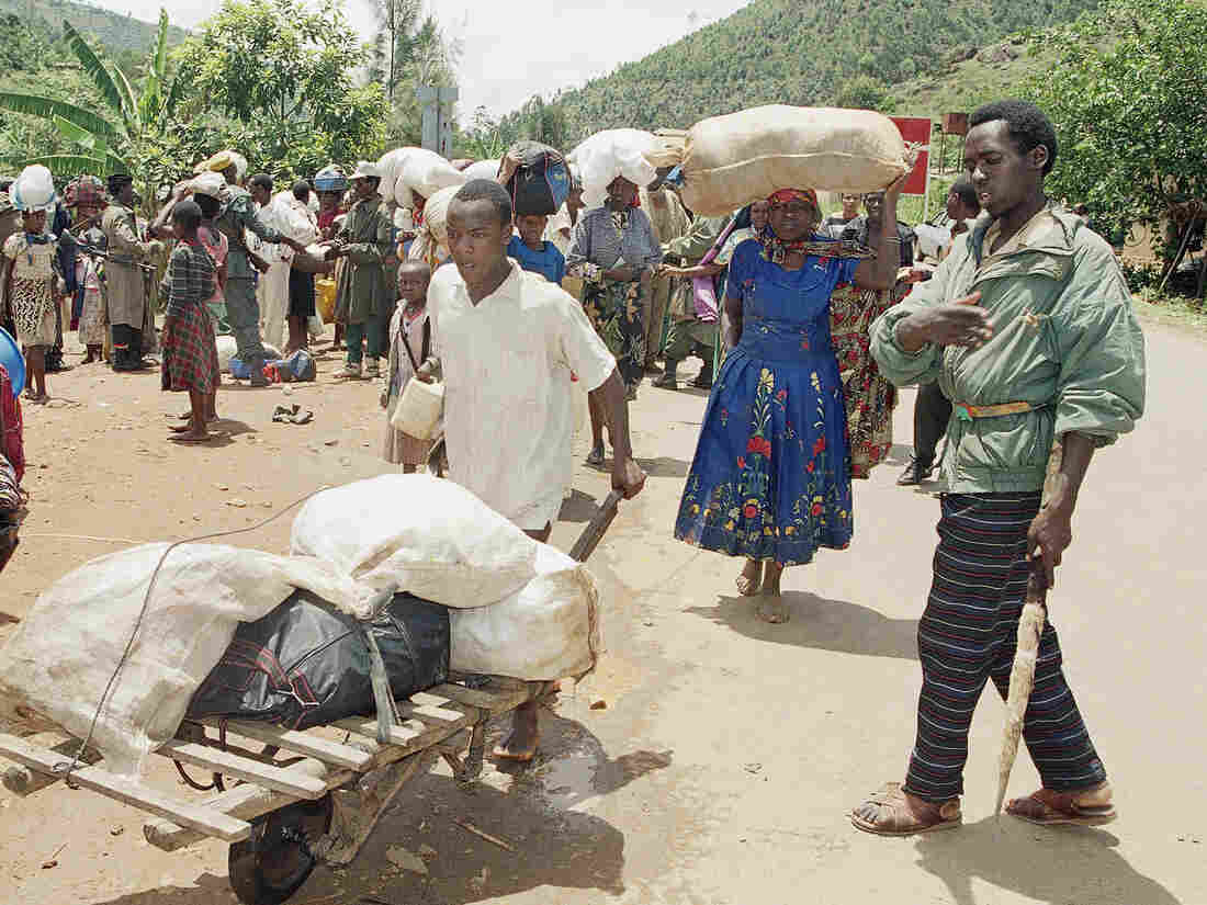 Dozens of Hutu refugees flee fighting between Hutus and Tutsis in Kigali, Rwanda, in April 1994, about a month before an internal White House email on the possible consequences of calling the killings a genocide.