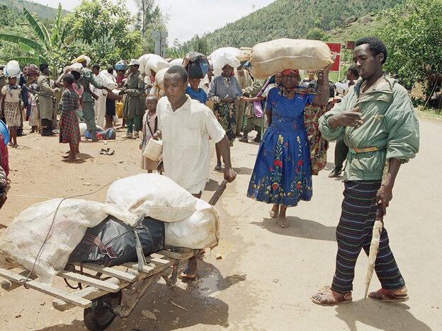 Dozens of Hutu refugees flee fighting between Hutus and Tutsis in Kigali,