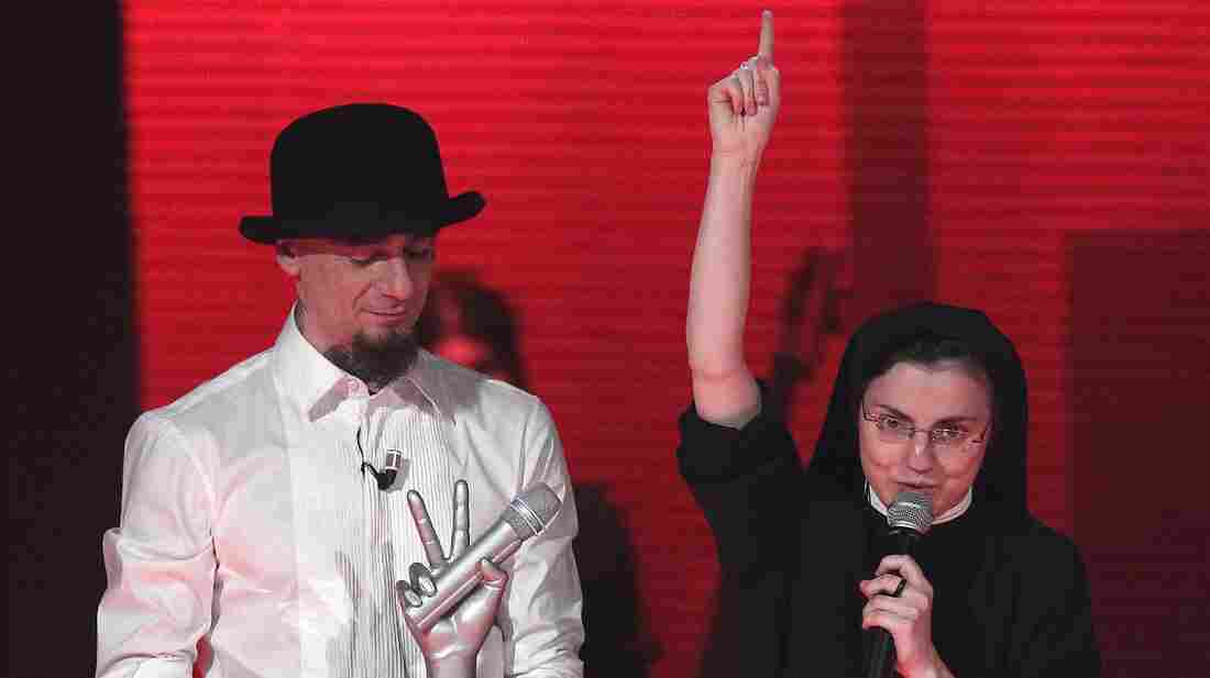 After winning Italy's version of The Voice, Sister Cristina Scuccia thanks God on stage in Milan alongside her coach, Italian rapper J-Ax.