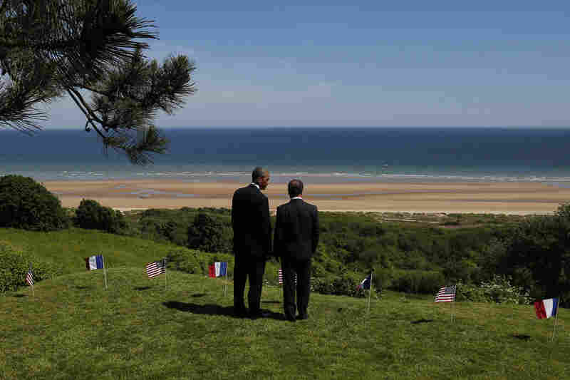 President Obama and French President Francois Hollande look out at Omaha Beach, one of the sites of the Allied soldiers' landings in Normandy.