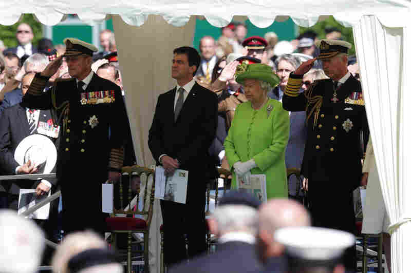 Prince Philip, Duke of Edinburgh (from left), French Prime Minister Manuel Valls, Queen Elizabeth II and Prince Charles, Prince of Wales, attend a service at Bayeux Cemetery during a commemoration Friday in Bayeux, France.