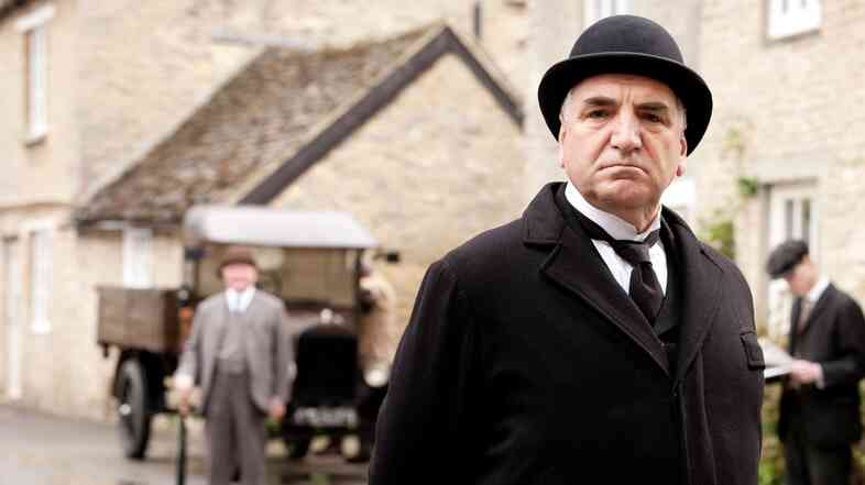 Jim Carter as Mr. Carson in Downton Abbey, which has helped fuel a growing demand for butlers around the world.