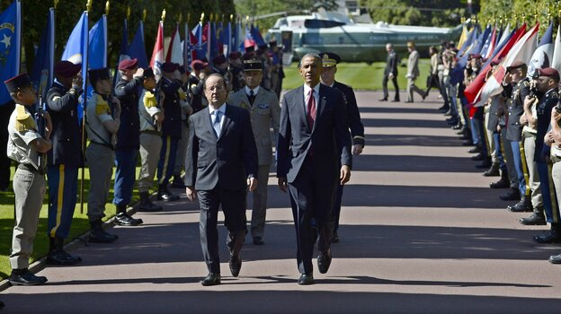 President Obama and French President Francois Hollande arrive at a D-Day anniversary ceremony on Friday.