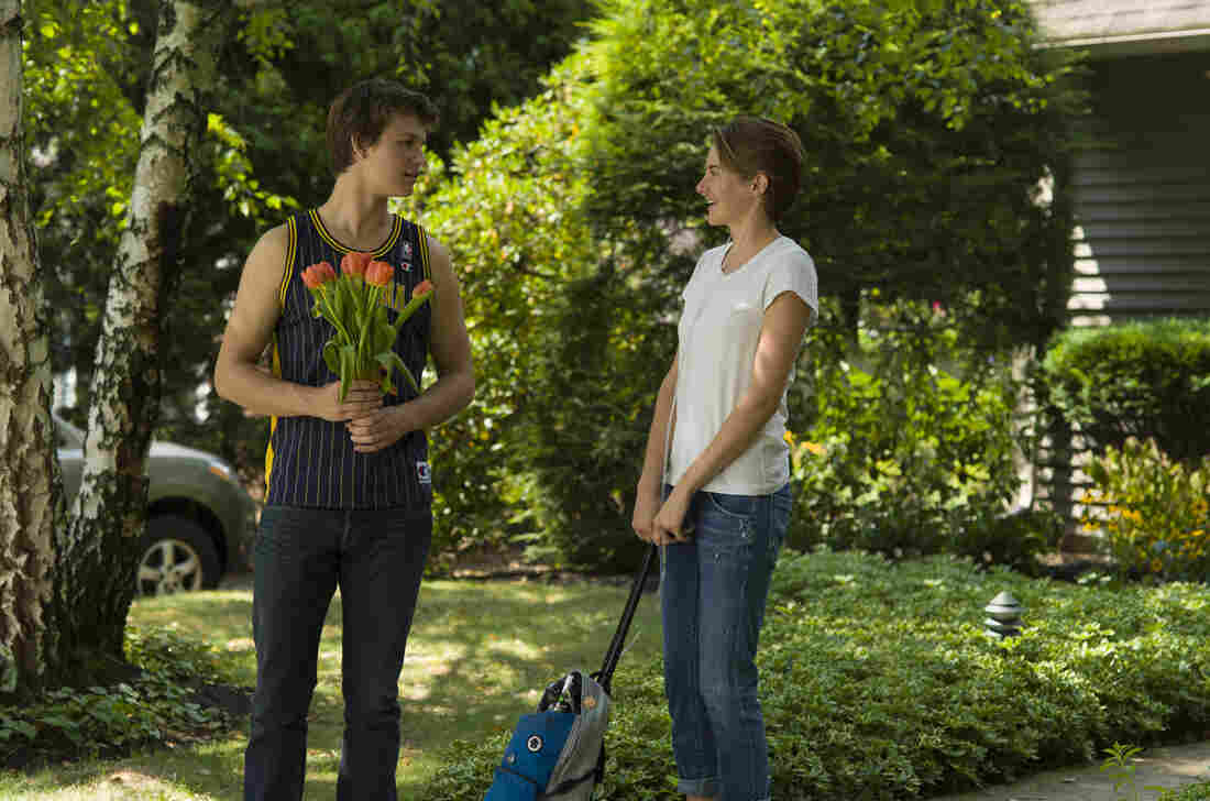 Ansel Elgort (Augustus) and Shailene Woodley (Hazel) star in The Fault in Our Stars, the film adaptation of John Green's bestselling young adult novel about two teens with cancer.