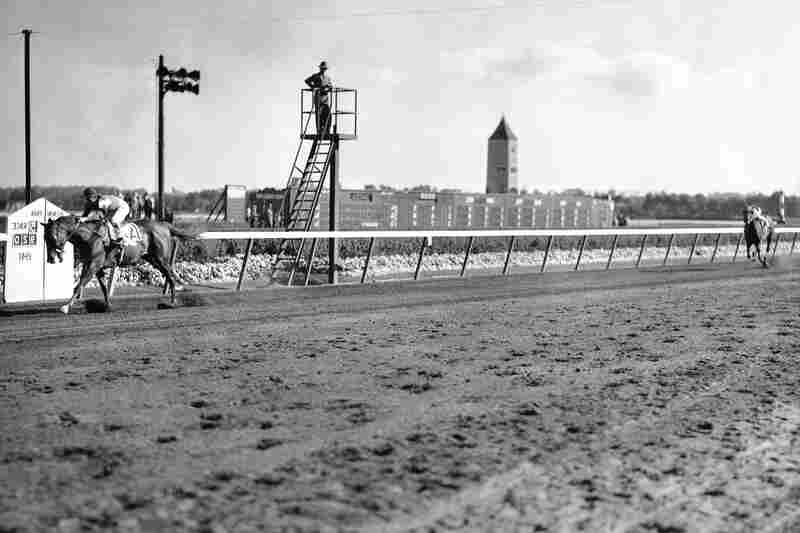 Whirlaway wins the Belmont Stakes at Belmont Park in 1941 — 10 lengths ahead of his competition.
