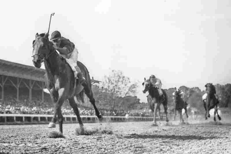 Citation, ridden by Eddie Arcaro, races home an easy winner in the Belmont Stakes in 1948.