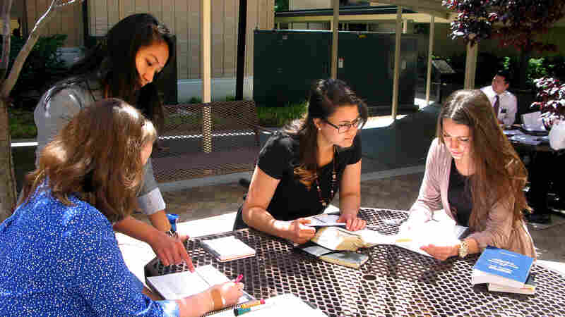 Mormon Training Center students (from left) Megan Jackson, Jessica Sagisi, Ashley Van Tonder and Kirsten Weiss study their language skills in preparation for their missionary work around the world.