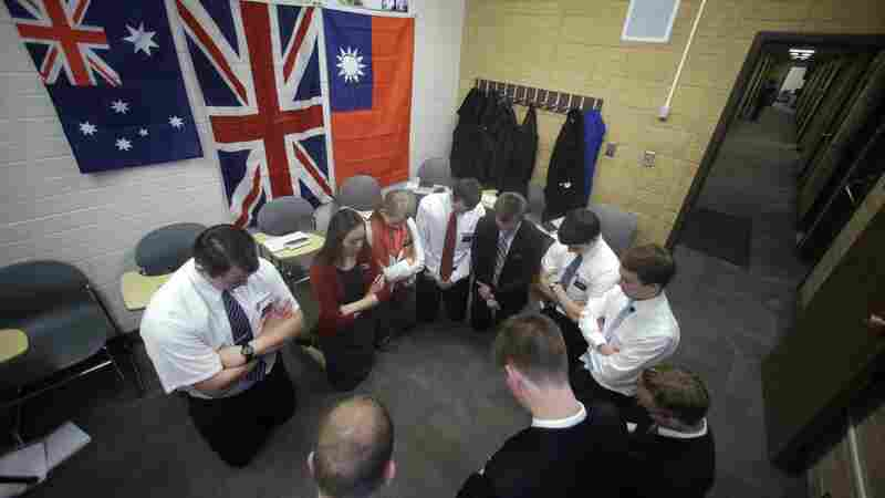 Mormon missionaries pray before the start of their Mandarin Chinese class at the Missionary Training Center, in Provo, Utah.