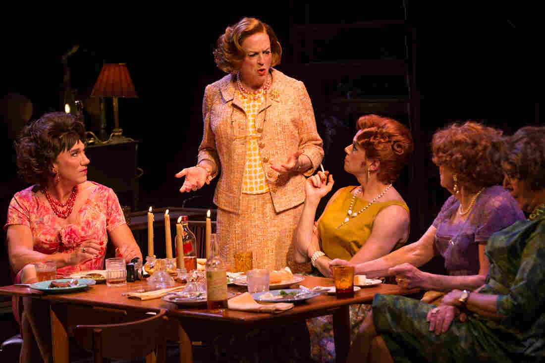 Wigs play an especially important role in the drama Casa Valentina. The play features Reed Birney (standing) as Charlotte, one of several male characters who spend their weekends dressing and living as women.