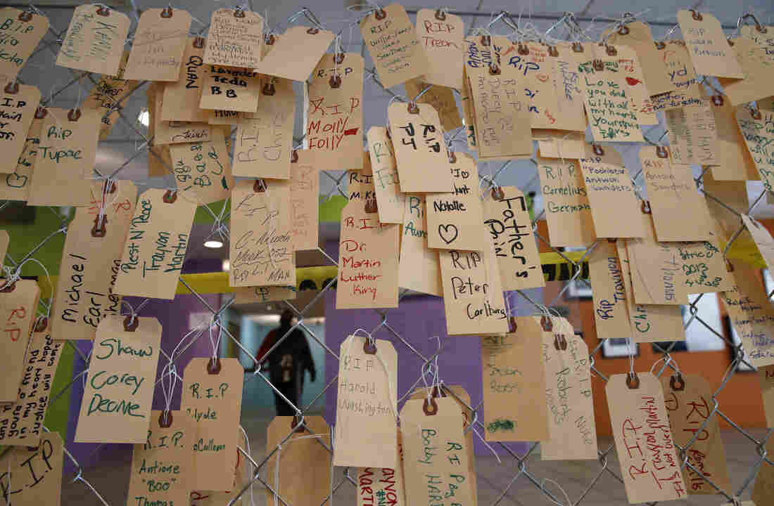 Name tags hang on a chain-link fence at the DuSable Museum of African American History in Chicago to represent the people who are victims of violence.