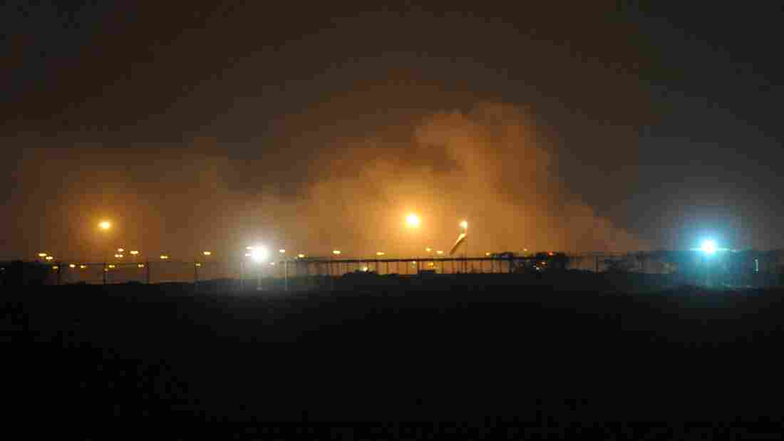 Smoke rises from the Karachi airport terminal after the militants' assault in Karachi on Sunday.