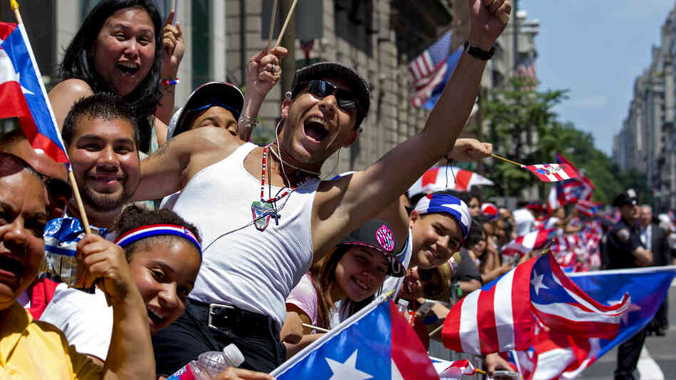Parade onlookers cheer marchers during last year's National Puerto Rican Day Parade in New York.