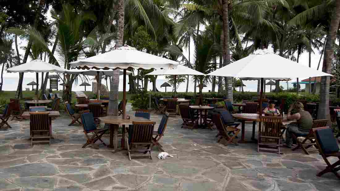 Two customers sit having a drink in the Diani Sea resort in Diani, Kenya, outside Mombasa, on May 16. Travel advisories issued by Western countries are hitting Mombasa hard, forcing hotel closures and thousands of wo
