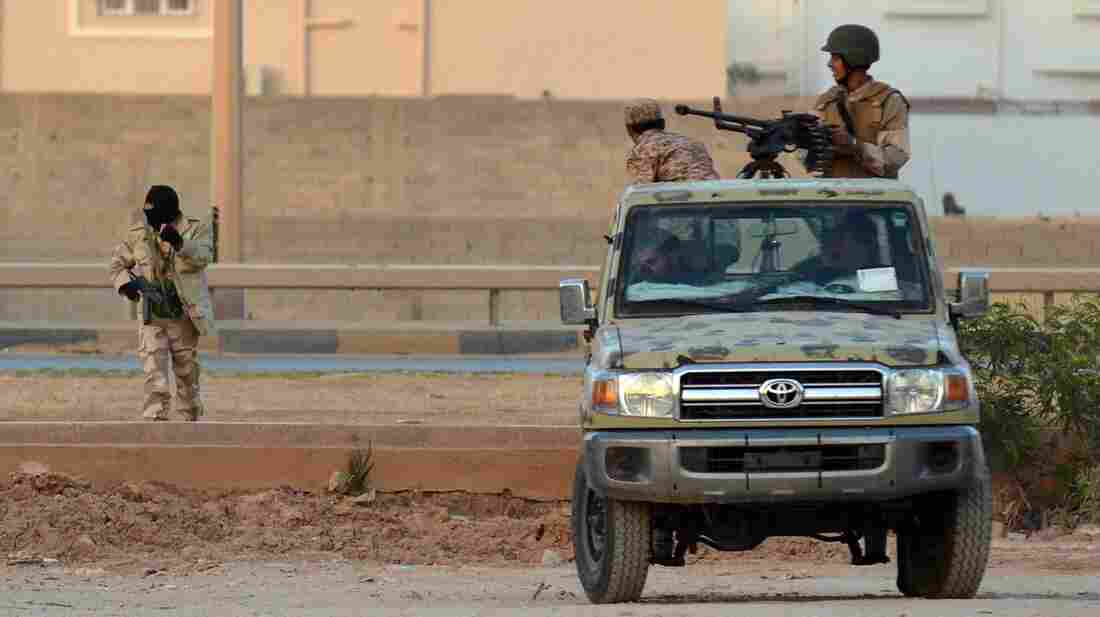 Libyan men loyal to rogue general Khalifa Hifter take position during clashes against Islamists in the eastern Libyan city of Benghazi on June 2.