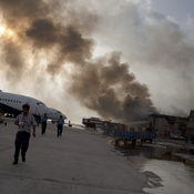 Smoke rises above Jinnah International Airport on Monday following a five-hour firefight between security forces and militants. The facility was slated to reopen Monday afternoon.