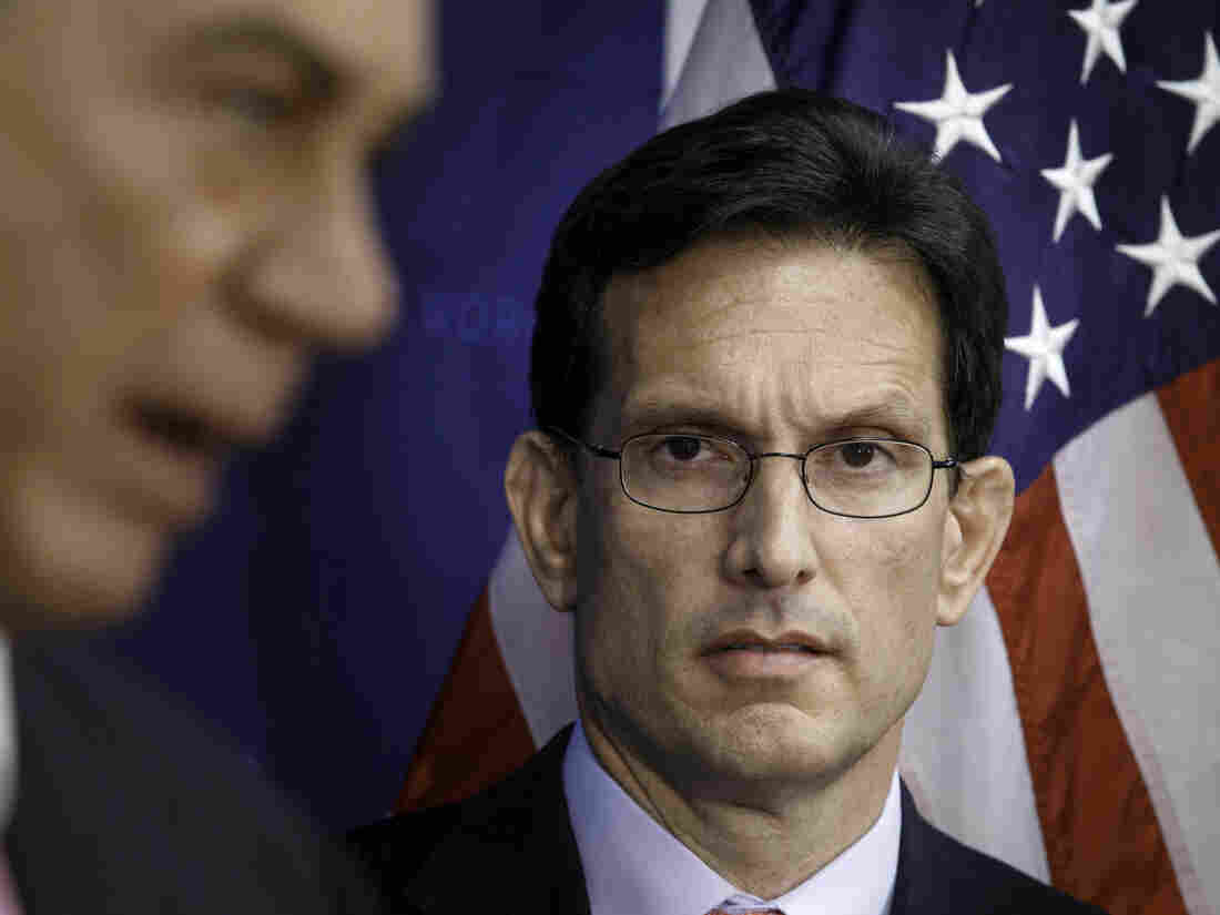 House Majority Leader Eric Cantor listens to House Speaker John Boehner at a recent news conference on Capitol Hill. Cantor, from Virginia's 7th Congressional District, lost the primary election Tuesday night, a stunning defeat.