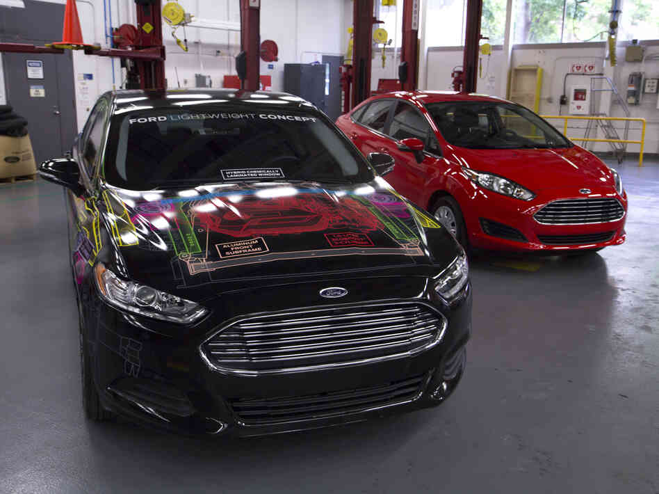 Ford says it cut the weight of its concept Fusion (left) by nearly 25 percent, matching the weight of a Ford Fiesta (right).