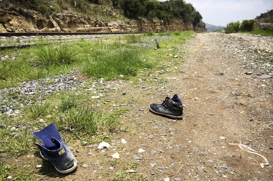 Strewn shoes are commonly found along the tracks outside Huehuetoca. As migrants run alongside the moving trains, they often lose their shoes in the scramble to climb aboard. (NPR)