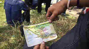 A migrant from El Salvador holds a map he received from church workers at the Mexico-Guatemala border. It shows the freight train schedules and routes to the U.S. border.