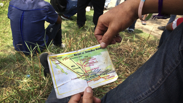 A migrant from El Salvador holds a map he received from church workers at the Mexico-Guatemala border. It shows the freight train schedules and routes to the U.S. border. (NPR)