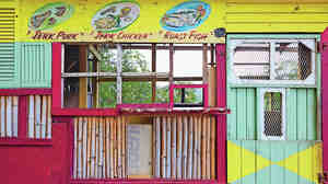 The pillars of Caribbean cuisine, framing the front of a streetside stall.