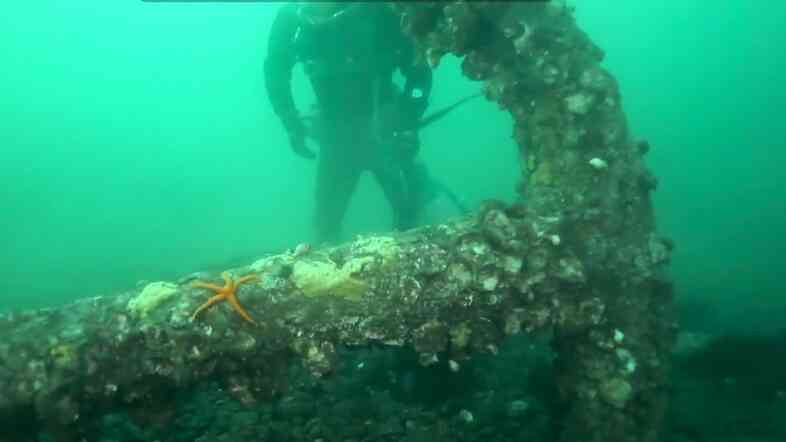 A screen grab from The Seattle Times shows the anchor beofre it was hoisted from the bottom of Puget Sound.