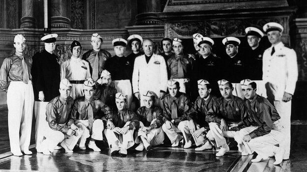 """Italian dictator Benito Mussolini (center, in white) poses in 1938 with the Italian national soccer team. Mussolini sent the team a telegram inviting the players to """"Win or die."""" Italy won that World Cup, beating Hungary 4-2."""