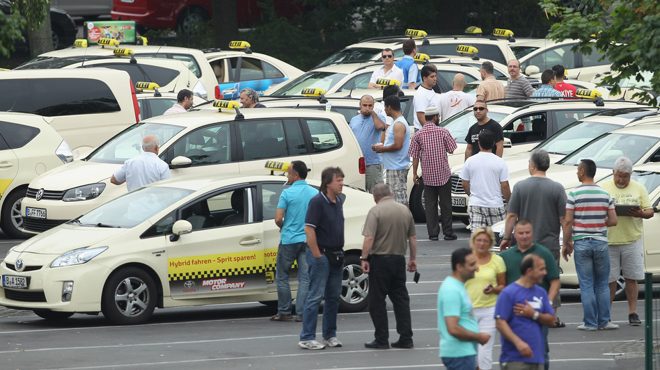 Taxi drivers gather in Berlin before joining an anti-Uber protest through the city. It coincided with similar protests in cities across Europe. (Sean Gallup/Getty Images)