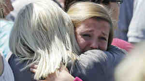 Freshman Hailee Siebert, 15, cries on her mother's shoulder after a shooting on Tuesday at Reynolds High School in Troutdale, Ore. The gunman has been identified as 15-year-old student Jared Michael Padgett.