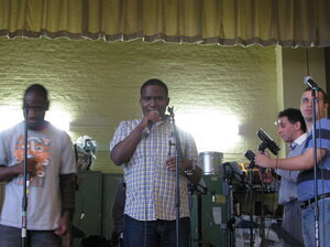 Jason Haughton sings an original tune composed by the PS 177 Technology Band.