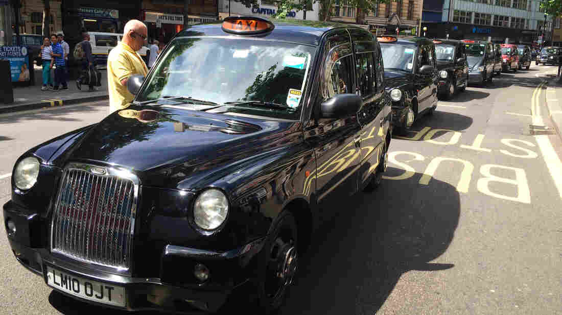 Traffic was snarled in London Wednesday as taxi drivers protested Uber by striking in the street.