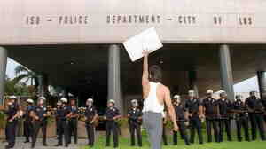 A demonstrator protests the verdict in the trial of four Los Angeles police officers accused of beating motorist Rodney King outside the Los Angeles Police Department.