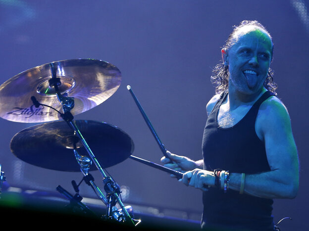 Drummer Lars Ulrich performs live with Metallica.