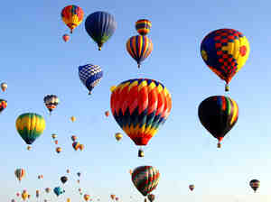 Hot air balloons fly overhead during a morning ascent at the Albuquerque International Balloon Fiesta in Albuquerque, N.M., on Oct. 8, 2005.
