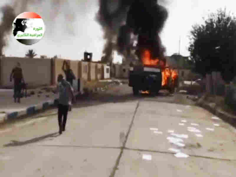 ISIS militants at al-Sharqat base north of Tikrit, Iraq. The al-Qaida-linked group has captured Mosul as well as Tikrit. This image came from a video posted by IraqiRevolution, a group that supports ISIS.