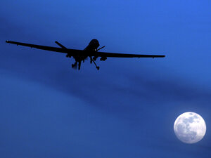An unmanned U.S. Predator drone flies over Kandahar Air Field, southern Afghanistan, on Jan. 31, 2010. U.S. drone strikes killed at least 13 people in two separate strikes Wednesday and