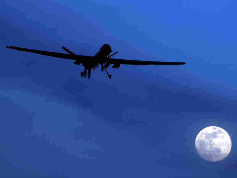 An unmanned U.S. Predator drone flies over Kandahar Air Field, southern Afghanistan, on Jan. 31, 2010. U.S. drone strikes killed at least 13 people in two separate strikes Wednesday and Thursday in Pakistan's tribal area.