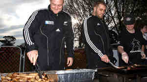 Rugby and meat: a treat for the gut? A study suggests yes. Here Tony Woodcock (left) and Owen Franks of the All Blacks rugby team turn sausages on the barbecue in 2011 in Christchurch, New Zealand.