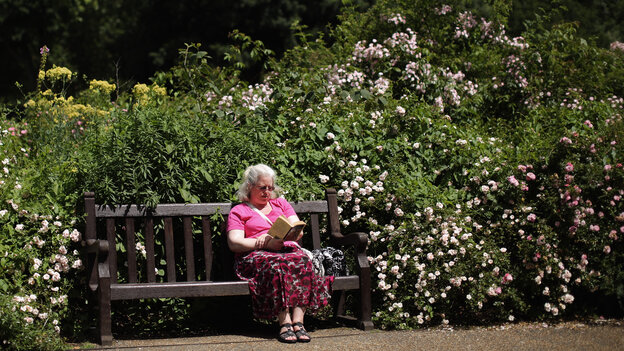 On a glorious but rare day, a woman relaxes on a bench in the rose garden in Hyde Park on Monday in London, England. The book she's reading might have turned out much different if London were known for fair weather rather than fog.