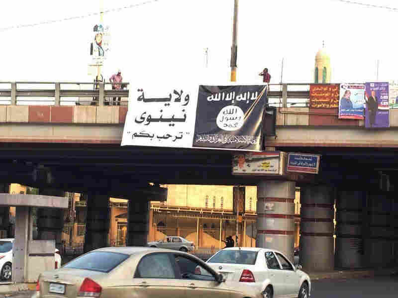 A banner bearing a black flag used by the al-Qa
