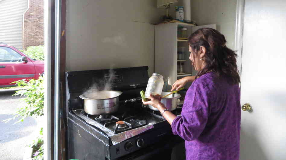 Tahira Ahmed sometimes cooks in a makeshift kitchen in her garage. Her daughter loves her cooking, but has resisted learning to cook her mother's signature Pakistani dishes.
