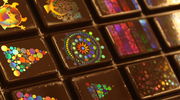 A company called Morphotonix has given traditional Swiss chocolate-making a colorful twist: It's devised a method to imprint shiny holograms onto the sweet surfaces.
