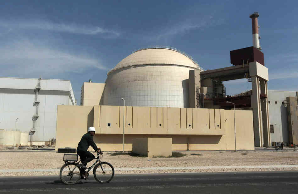 A worker rides a bicycle in front of the Bushehr nuclear power plant in Iran in 2010. Iran and six world powers are meeting in Vienna this week with the goal of reaching a comprehensive deal on Iran's nuclear program before a July 20 deadline.