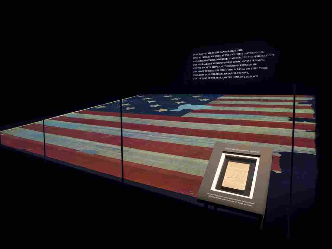 The Star-Spangled Banner manuscript and flag together in a gallery at the National Museum of American History.